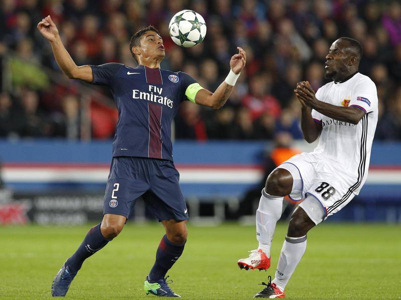 Thiago Silva, left, controls the ball during a Champions League match between Paris Saint-Germain and Basel.