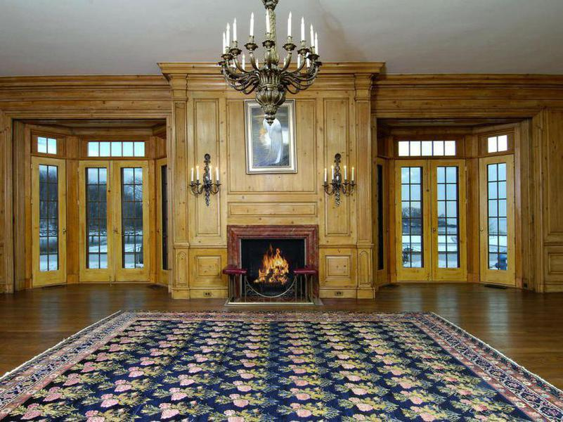 The expertly decorated living room includes a 19th century fireplace with intricate millwork.