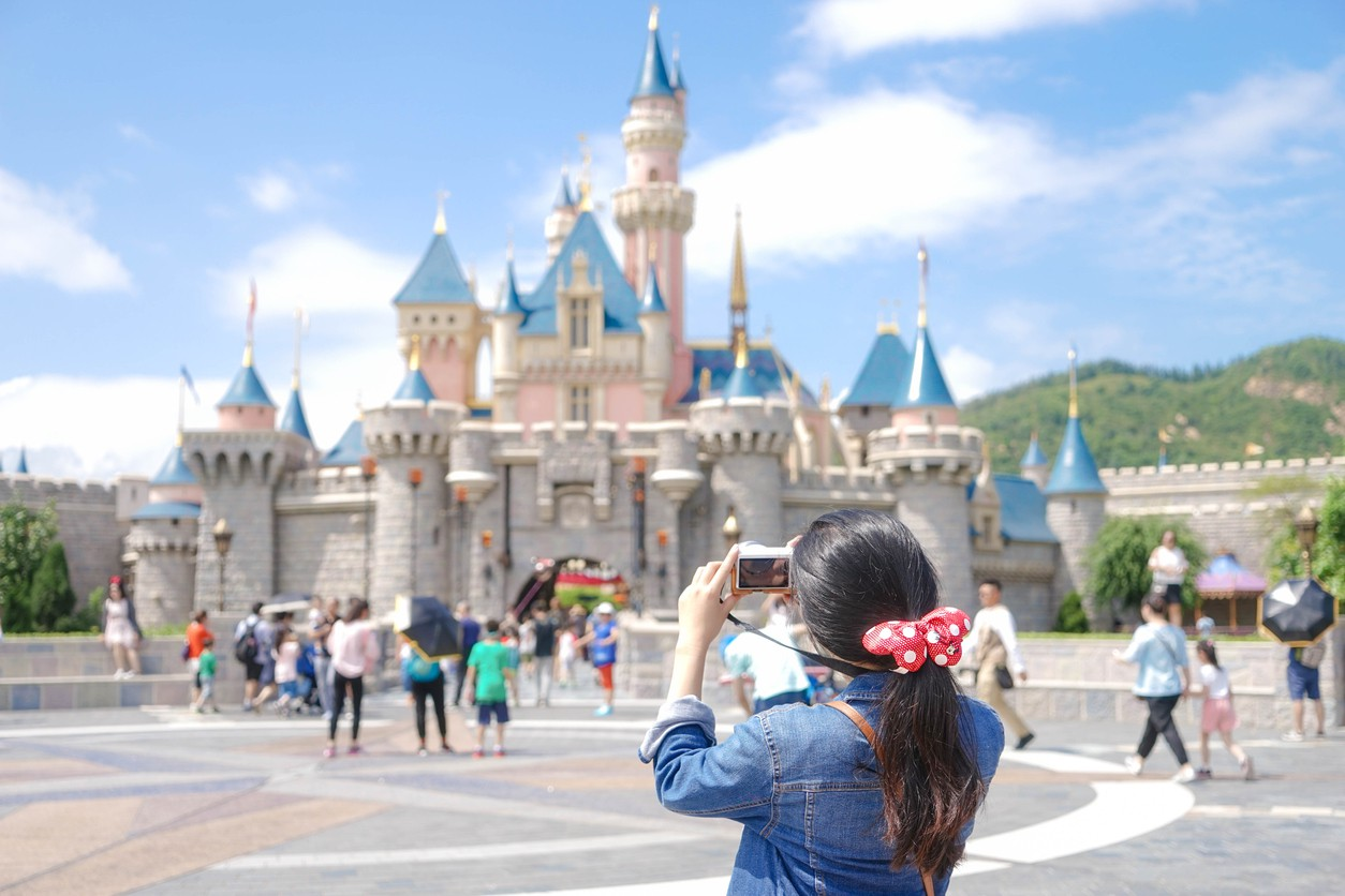 Woman taking pictures at Disney