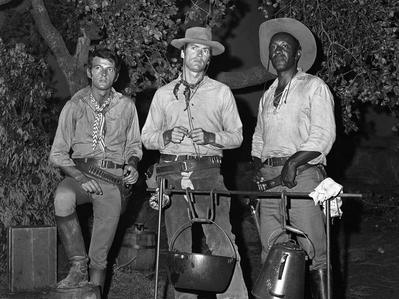 """""""Rawhide"""" stars Clint Eastwood, David Watson (left) and Raymond St. Jacques (right) pose on set in 1965."""