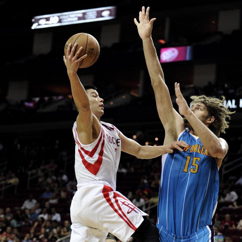 Houston Rockets' Jeremy Lin goes to basket