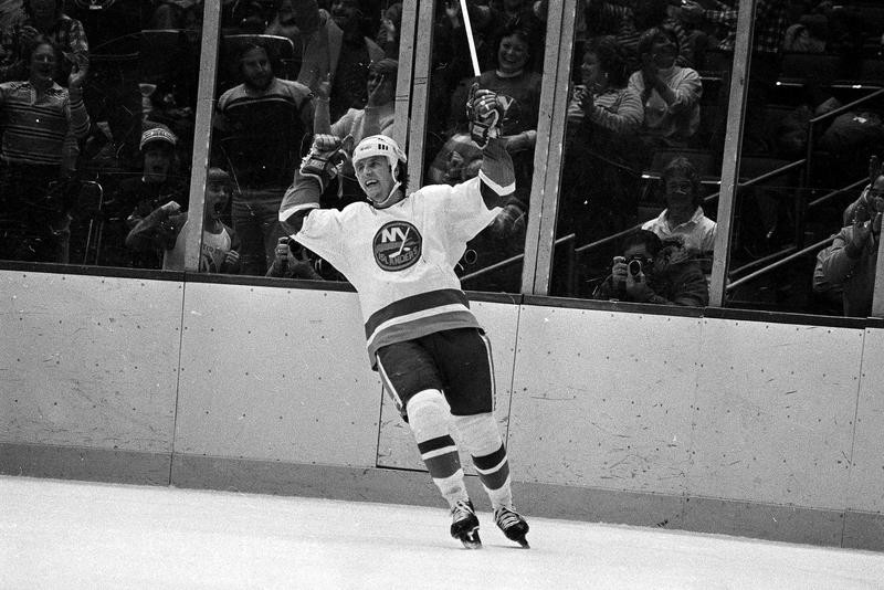 Mike Bossy cheers after his hat trick