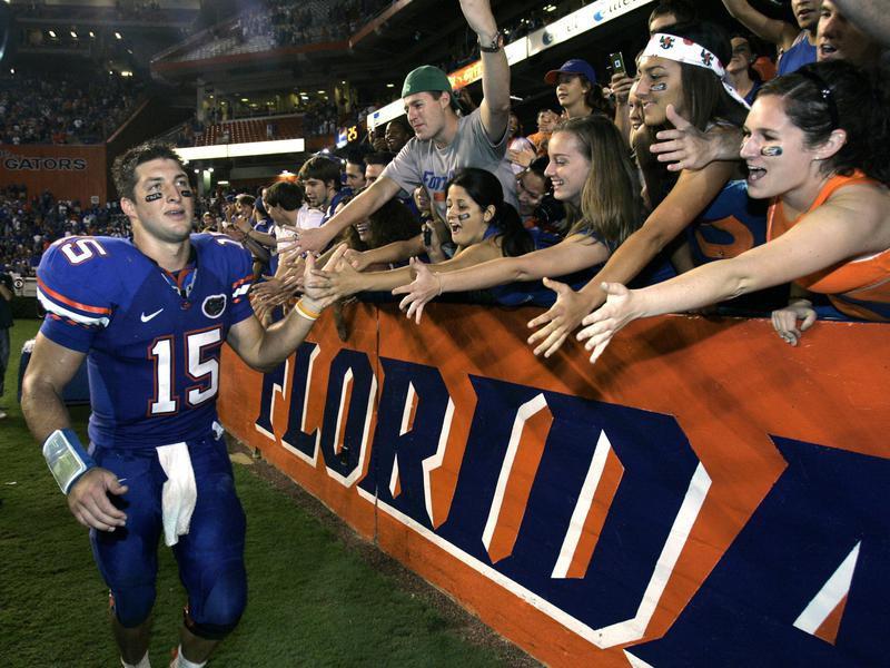Florida quarterback Tim Tebow high-fives fans
