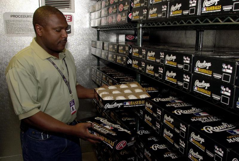 Tony Cowell inspects baseballs stored in humidor