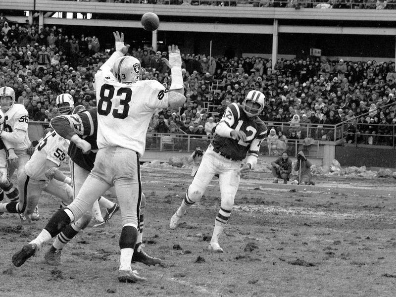 Joe Namath passes against the Oakland Raiders.