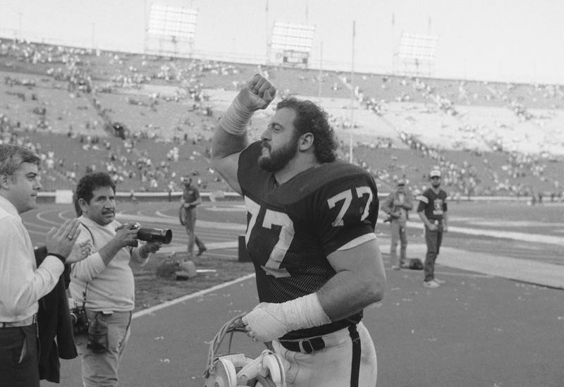 Lyle Alzado of the Los Angeles Raiders gives victory fist after beating Steelers in playoffs