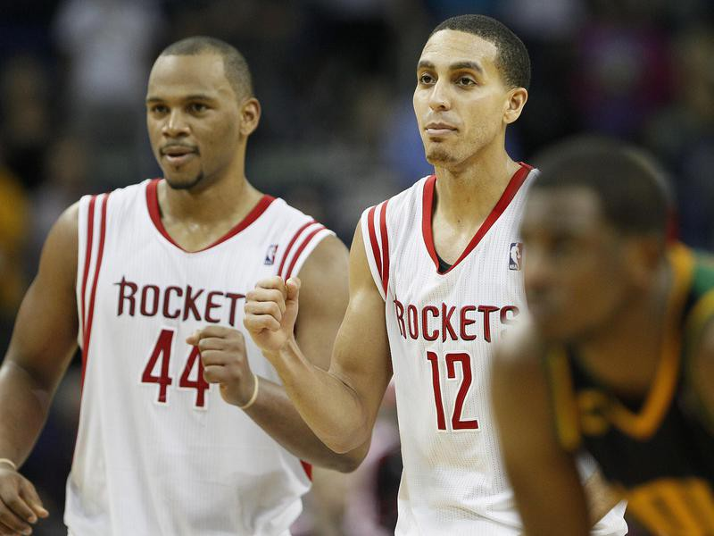 Chuck Hayes reacts with Kevin Martin