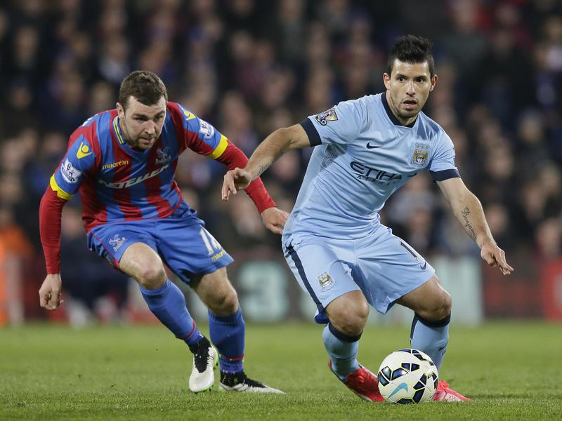 Manchester United's Sergio Agüero, right, competes with Crystal Palace's James McArthur during an English Premier League match.