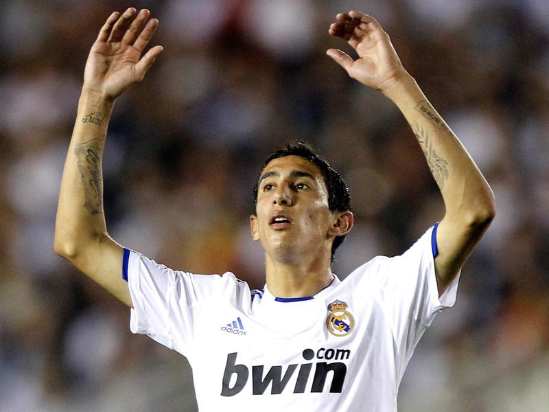 Ángel Di María, then with Real Madrid, reacts after kicking the ball over the goal.