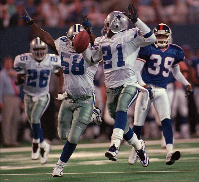 Deion Sanders heads for a touchdown