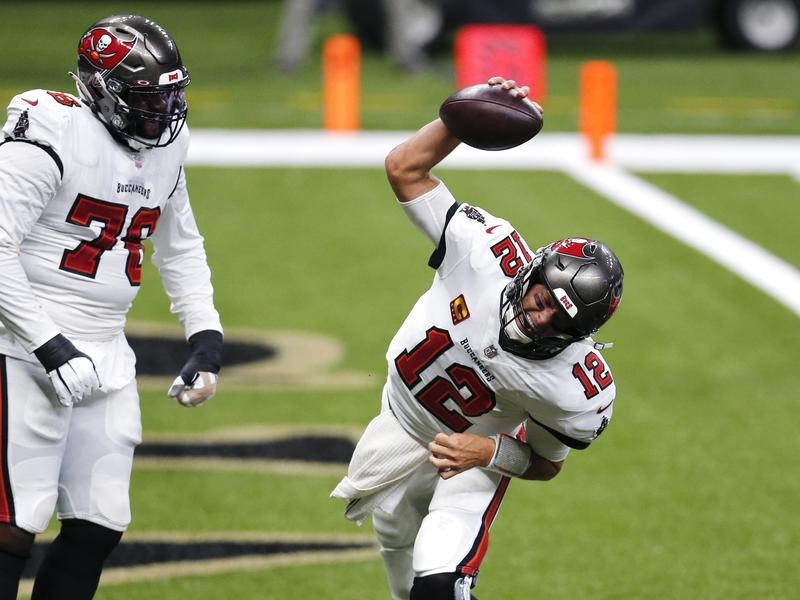 Tom Brady spikes the football