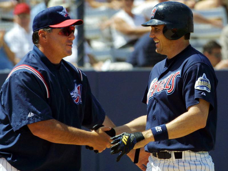 Tim Salmon congratulated by manager Mike Scioscia