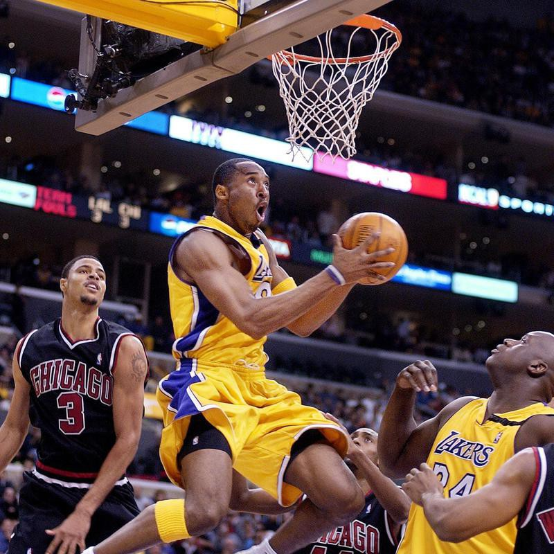 Kobe Bryant goes up for shot as Shaquille O'Neall looks on