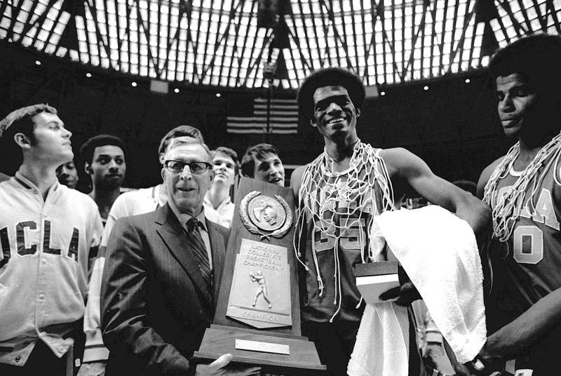 John Wooden holds championship trophy with Bruins