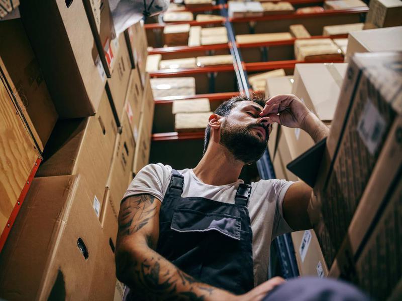 man having a hard day at work