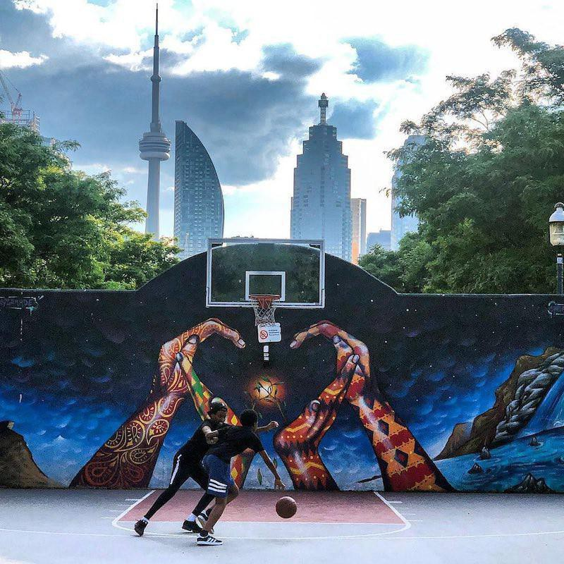 Boys playing at David Crombie Park Basketball Court