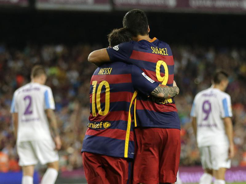 Lionel Messi embraces to his teammate Luis Suarez