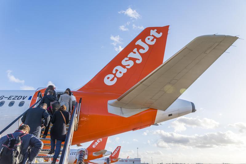 Passengers board Easyjet airplane
