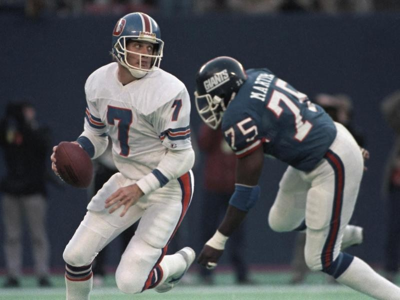 John Elway playing quarterback for Denver Broncos