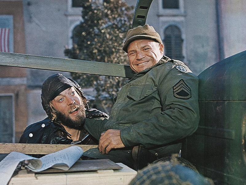 "Donald Sutherland (left) and Don Rickles are among the stars who go behind enemy lines to steal a cache of Nazi gold in ""Kelly's Heroes."""
