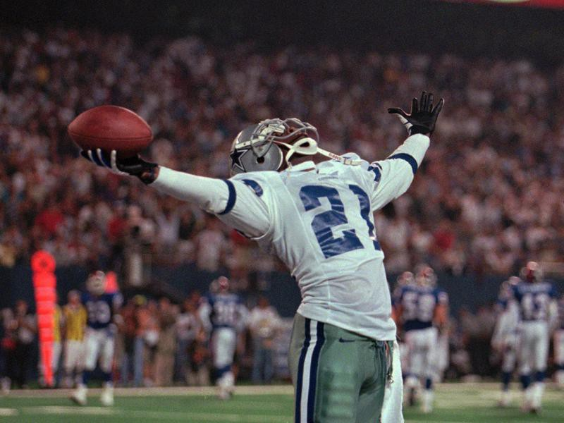 Deion Sanders of the Dallas Cowboys holds for applause from the crowd