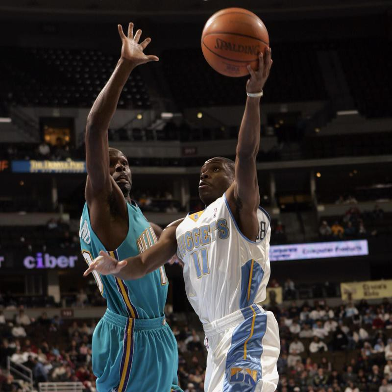 Earl Boykins goes up for a shot against New Orleans Hornets guard Darrell Armstrong