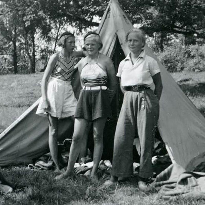 Young Woman in Trousers with Friends
