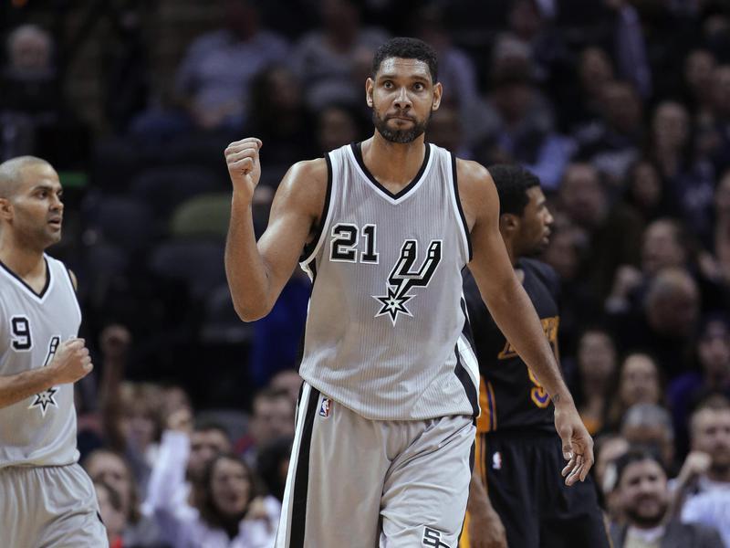 San Antonio Spurs' Tim Duncan and Tony Parker celebrate