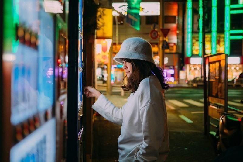 woman at vending machine