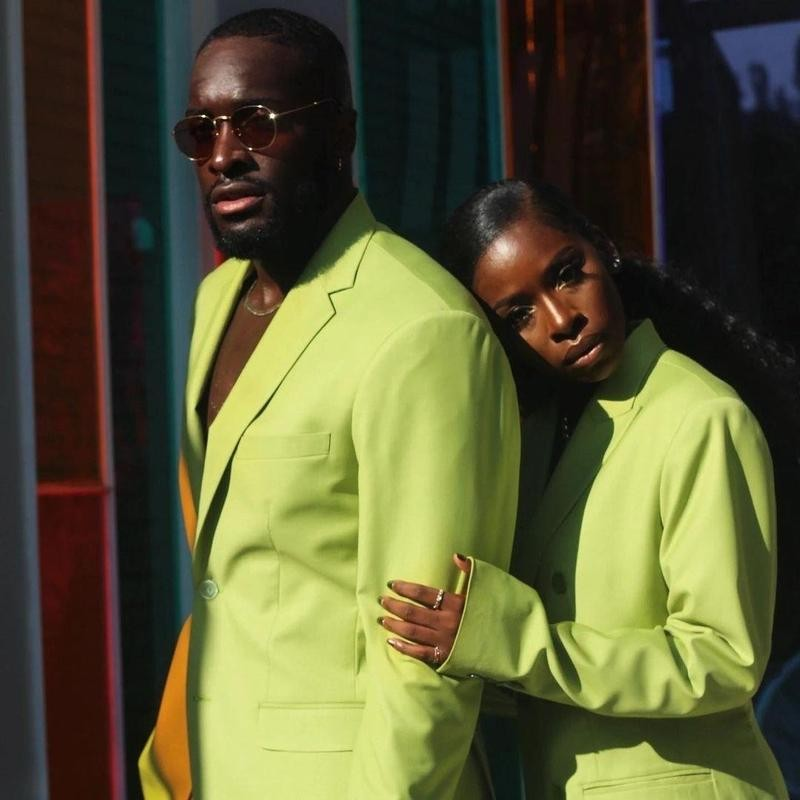 Man and woman in green jacket