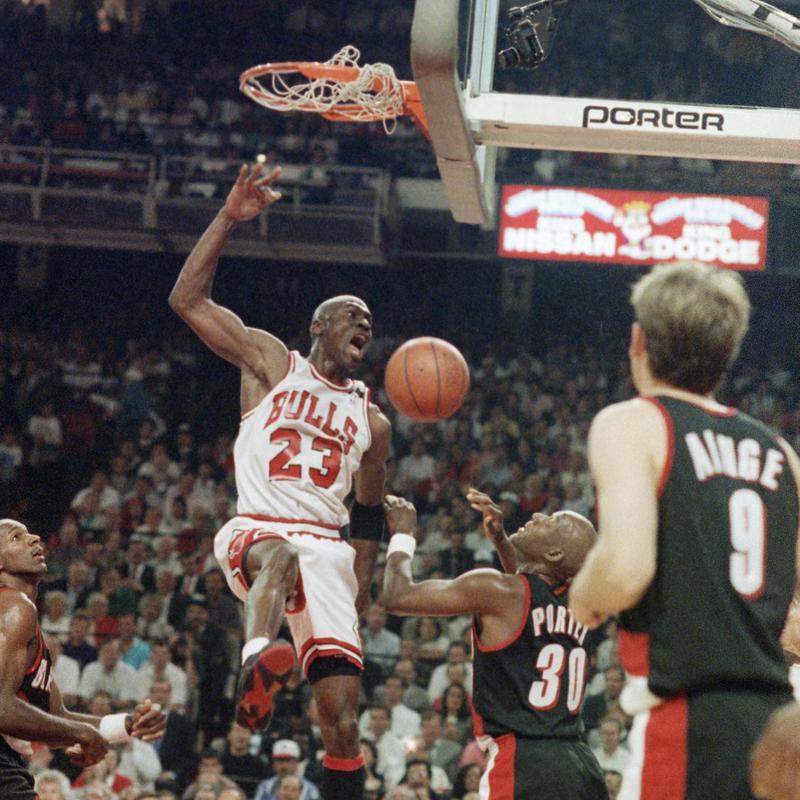 Michael Jordan slams the ball