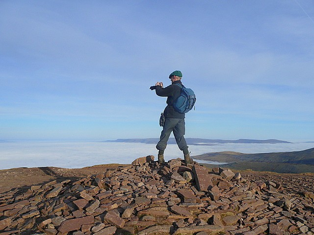 Geographer on rocks