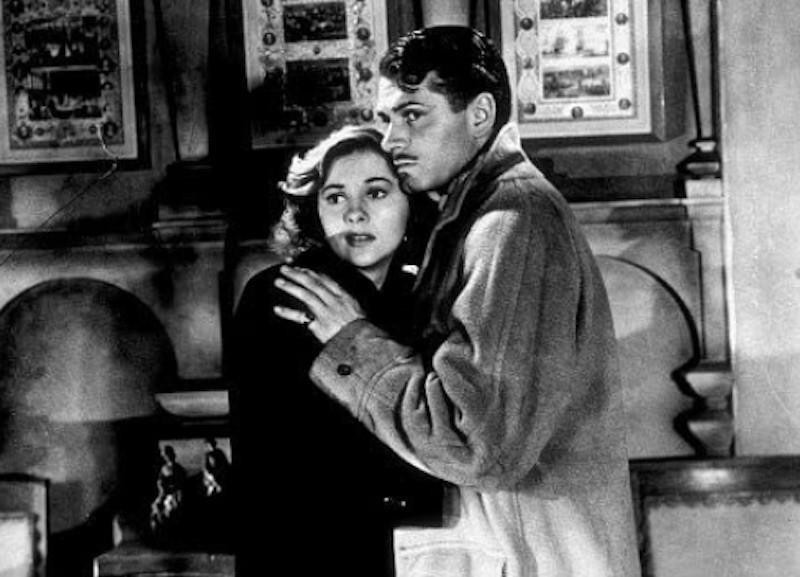 Joan Fontaine and Laurence Olivier hugging in Rebecca
