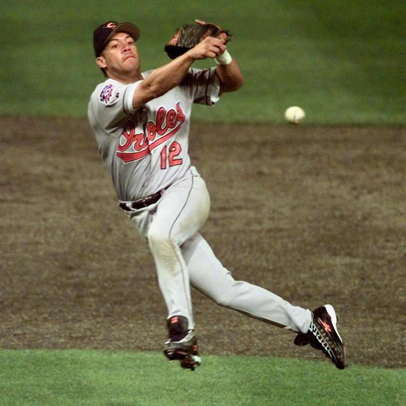 Baltimore Orioles' Roberto Alomar throws out Cleveland Indians' Bip Roberts