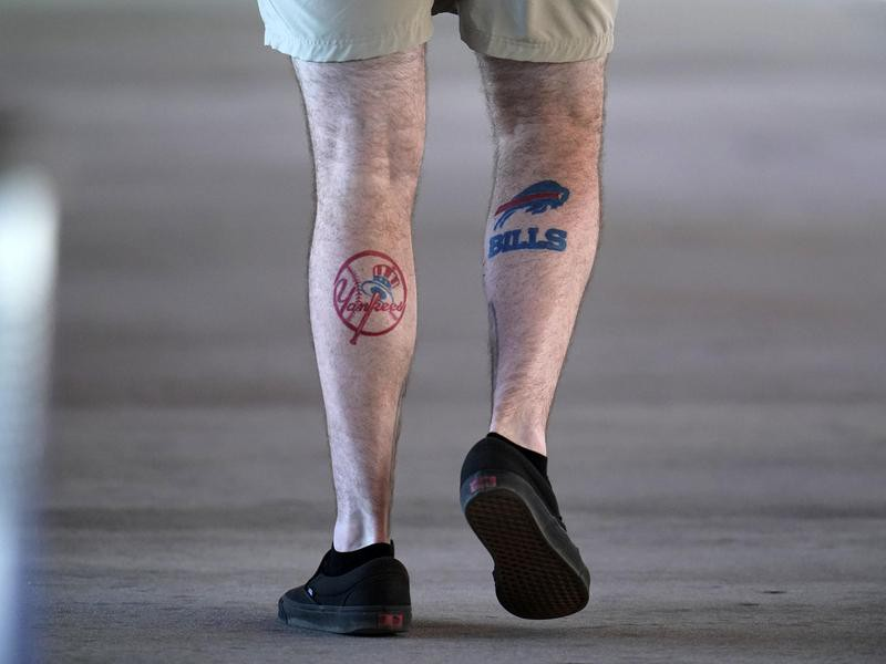 Fan with Yankee and Bills tattoos