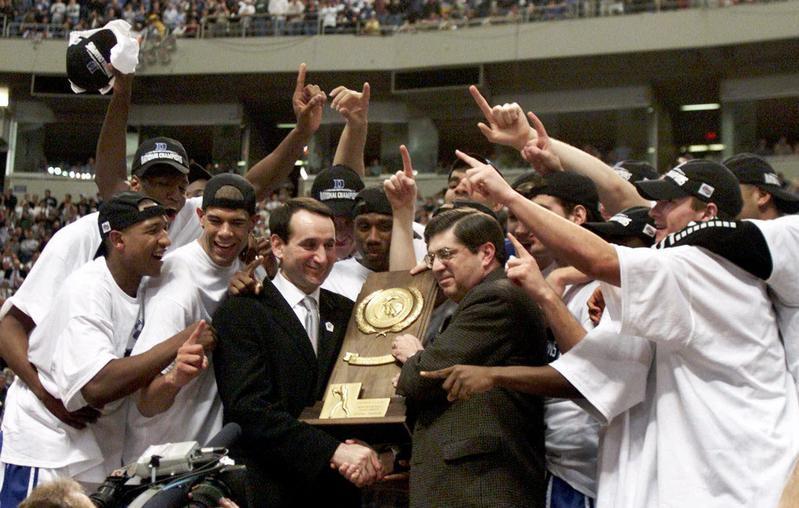 Duke head coach Mike Krzyzewski and Blue Devils players celebrate