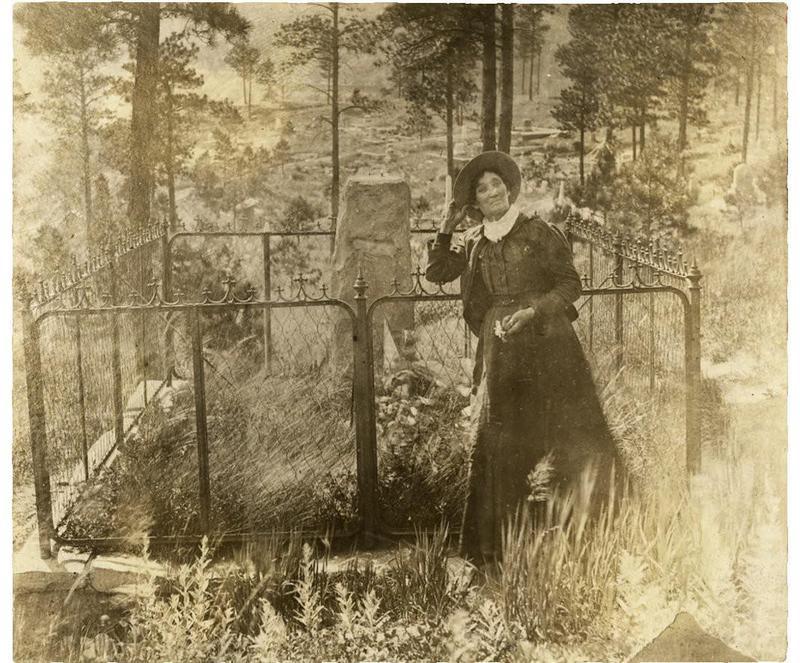 Calamity Jane at Wild Bill Hickok's grave