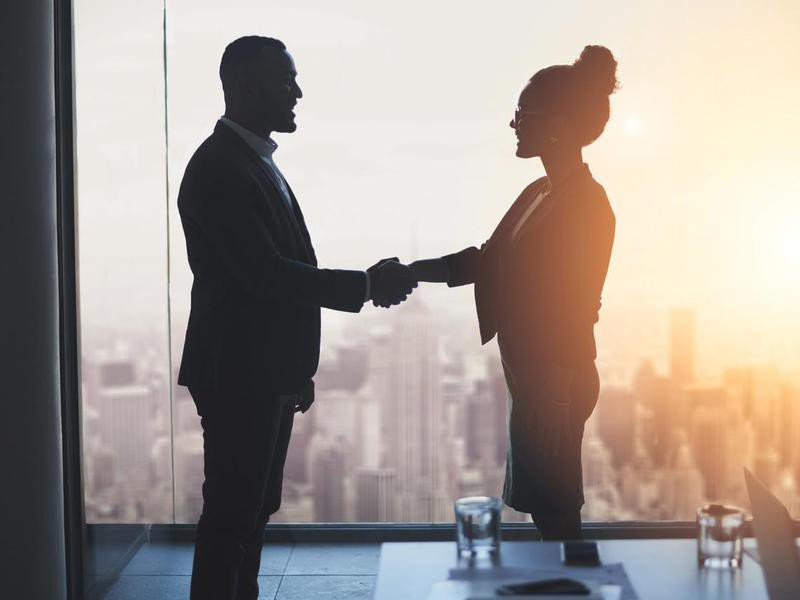 employees shaking hands
