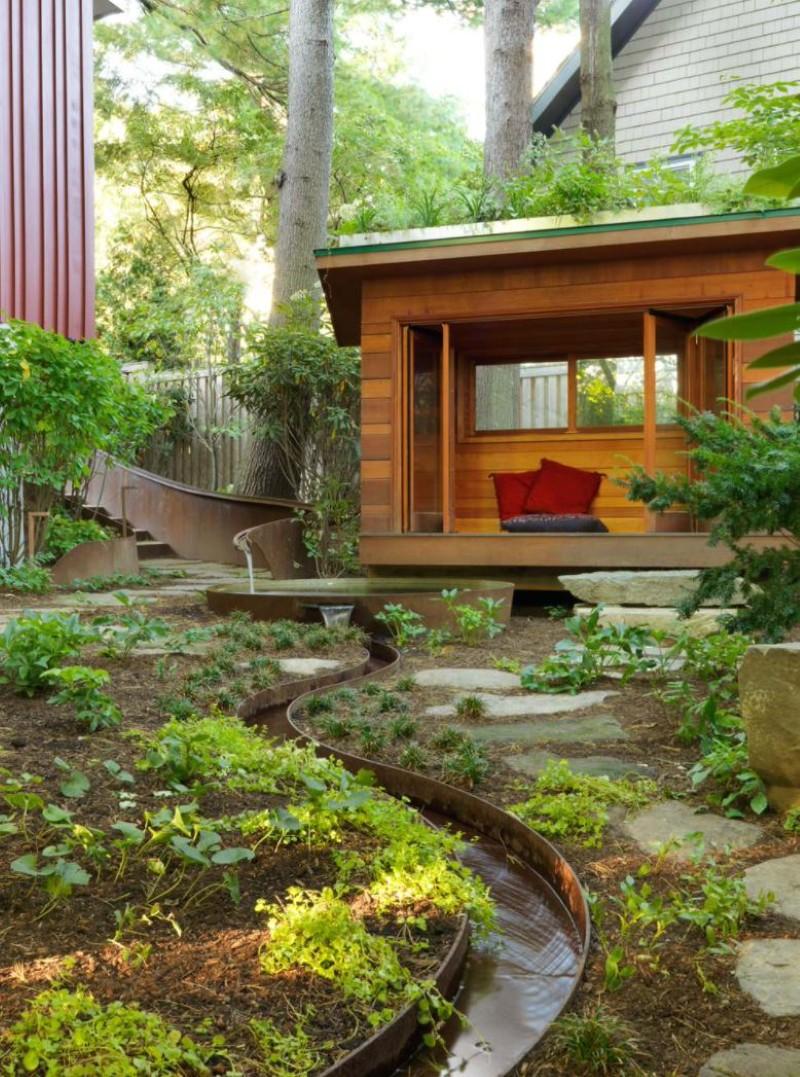 Contemporary garden with corten steel drainage