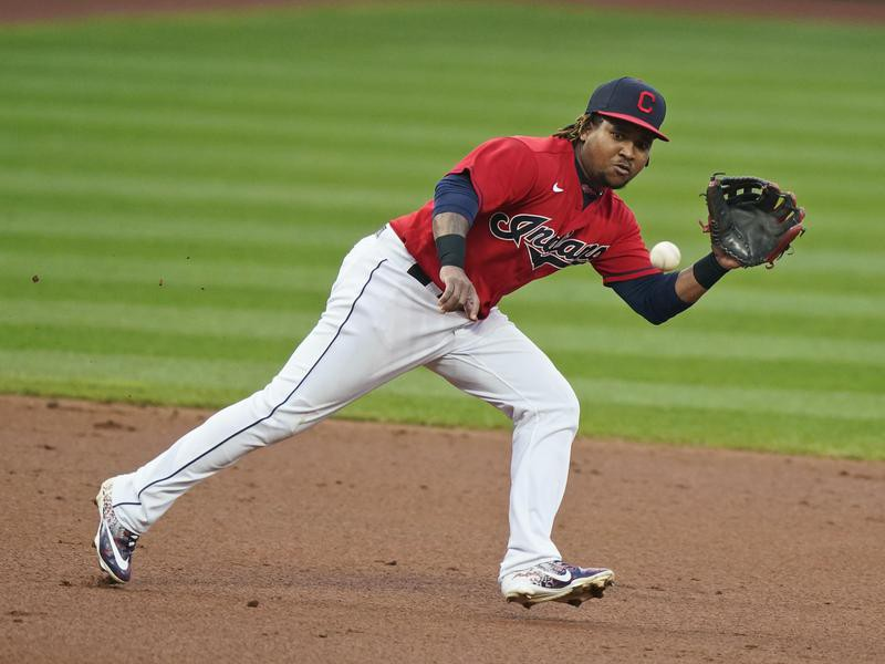 Jose Ramirez of Cleveland fields a ball hit by Chicago White Sox's Nick Madrigal