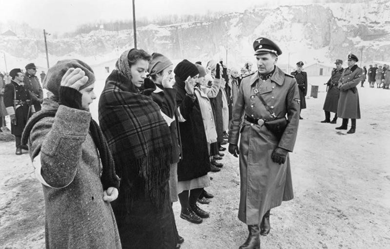 Ralph Fiennes surveying the group in Schindler's List