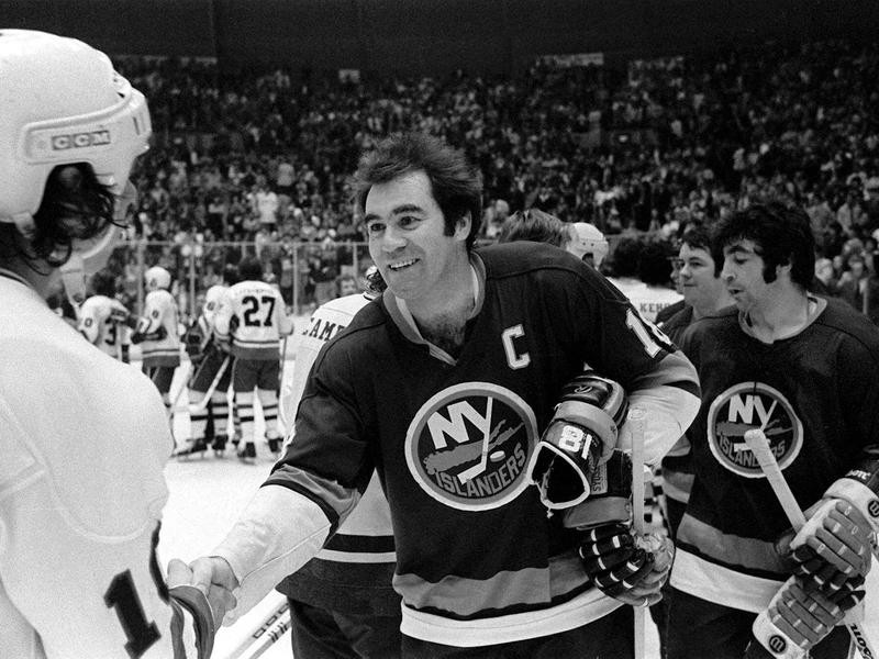 New York Islanders Ed Westfall shakes hands with Pittsburgh Penguins Pierre Larouche
