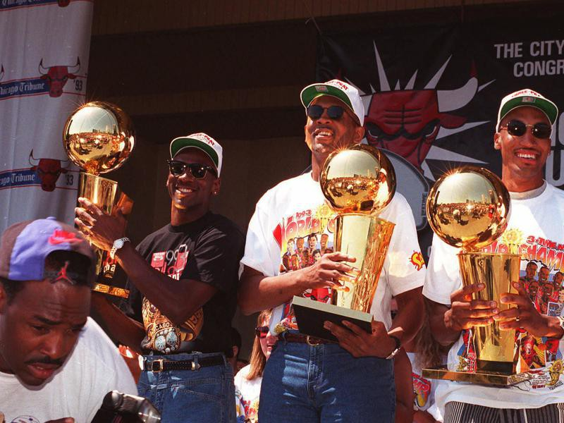 Bill Cartwright and Scottie Pippen show off team's NBA Championship trophies