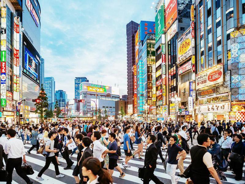 People crossing the street in Japan