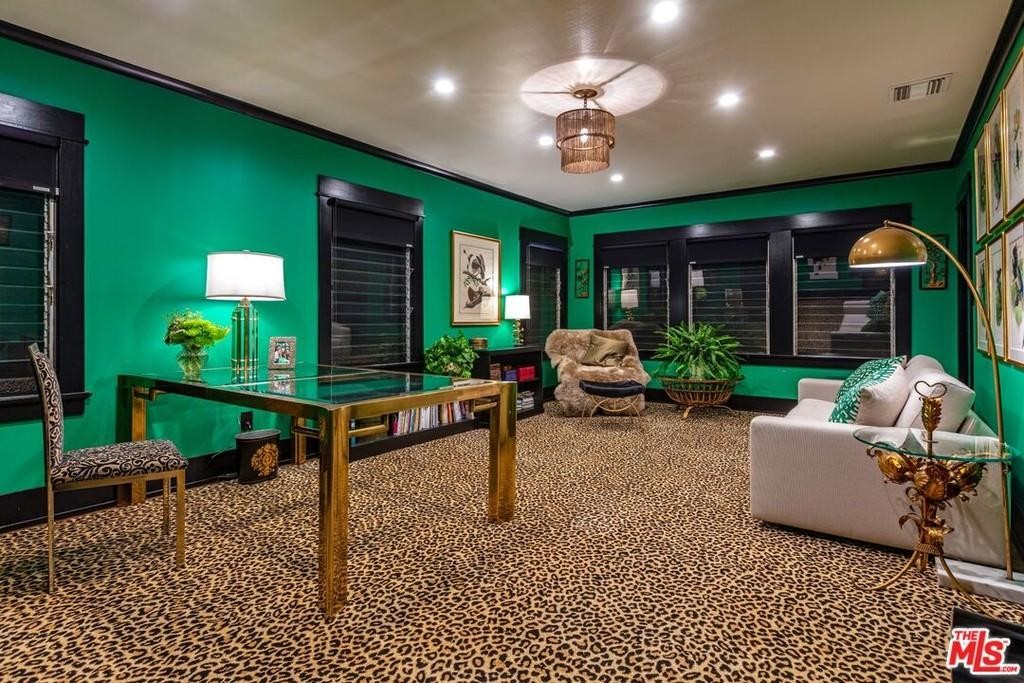 Room with green paint and leopard print carpet