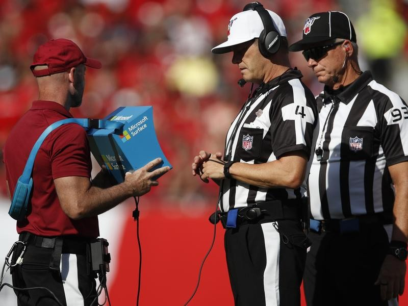 Referee reviews instant replay