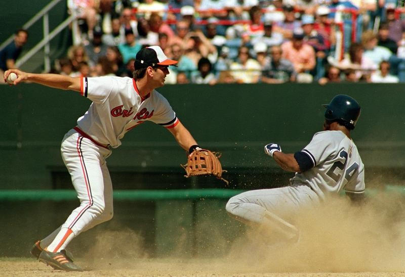 Billy Ripken forces out Rickey Henderson of the New York Yankees in Baltimore