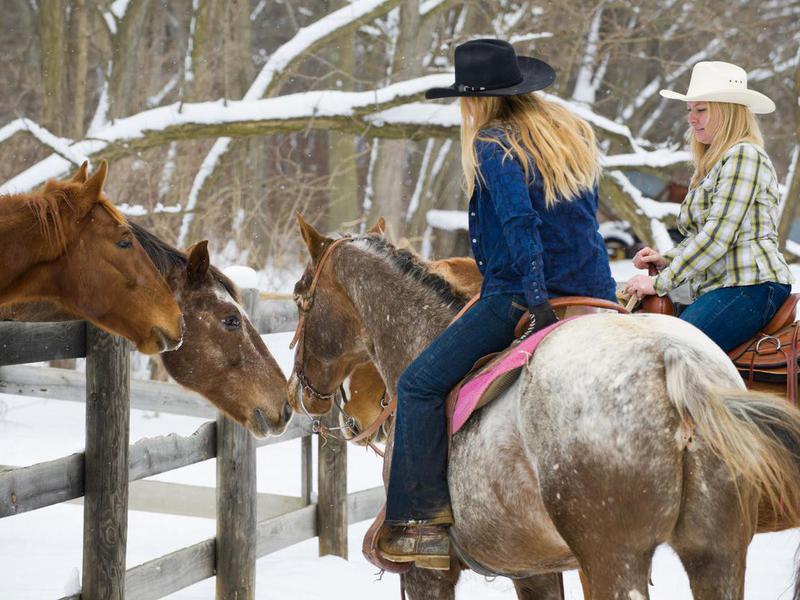 Young women on Appaloosa horses