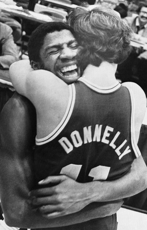 """Michigan State's Earvin """"Magic"""" Johnson hugs Terry Donnelly after the Spartans beat Notre Dame"""