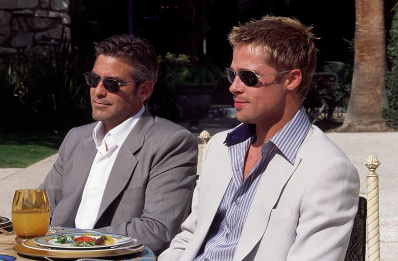 "Heist films, like 2001's ""Ocean's Eleven"" with George Clooney (left) and Brad Pitt, have been thrilling audiences with their cool adrenaline since the 1950s."
